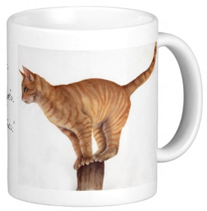 Ginger Cat Balancing on Mug